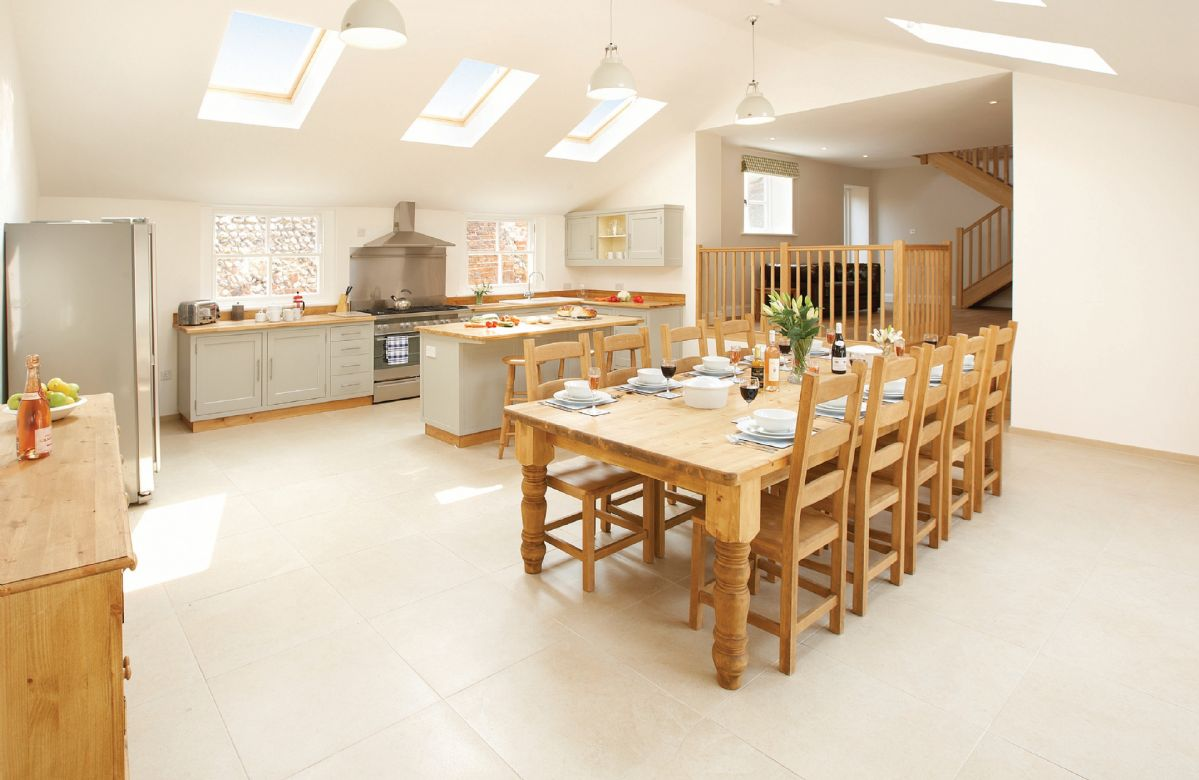 Ground floor: Large barn style kitchen/dining room with large doors to open outside to patio and back garden