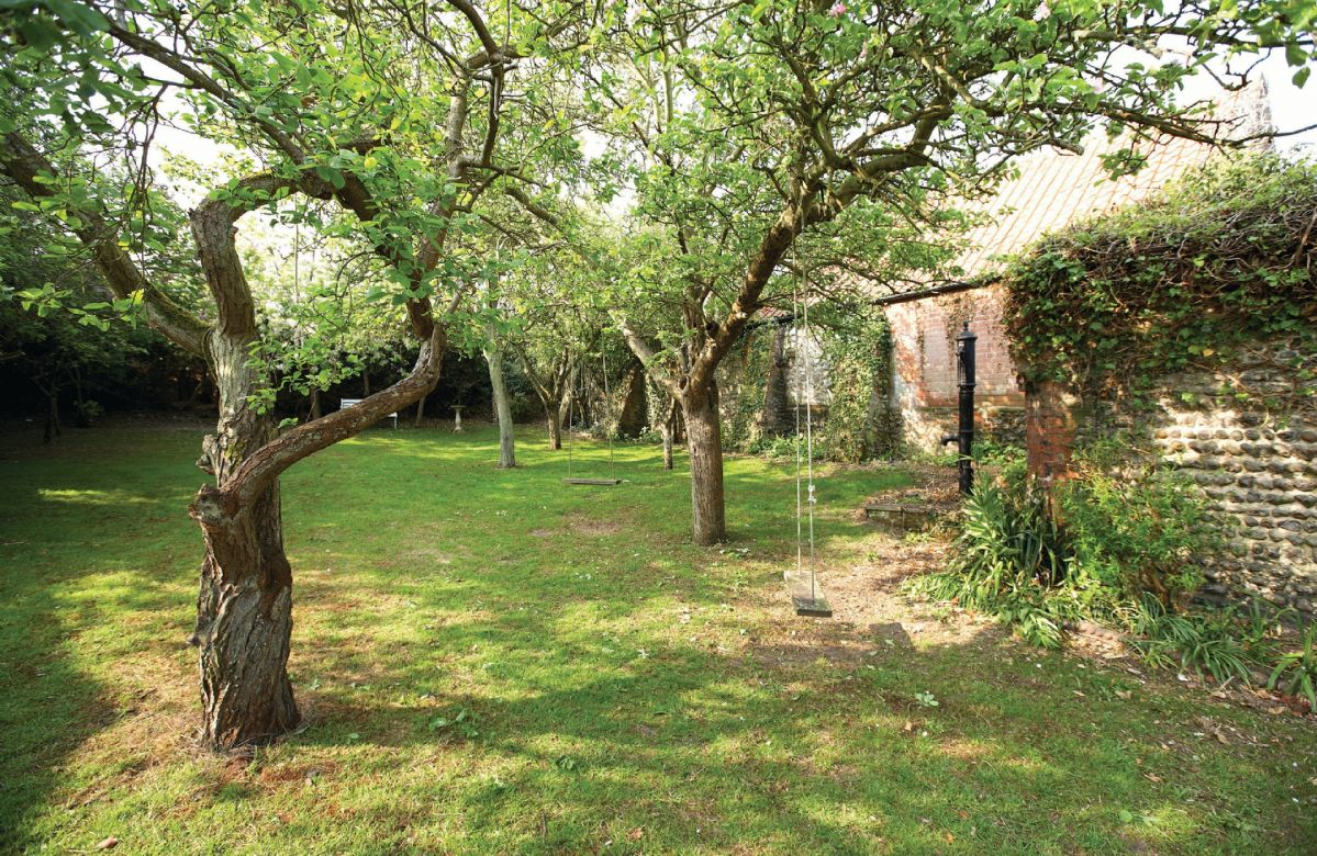 The large rear garden, which is walled and south facing, has mature fruit trees and a large patio, perfect for outside dining