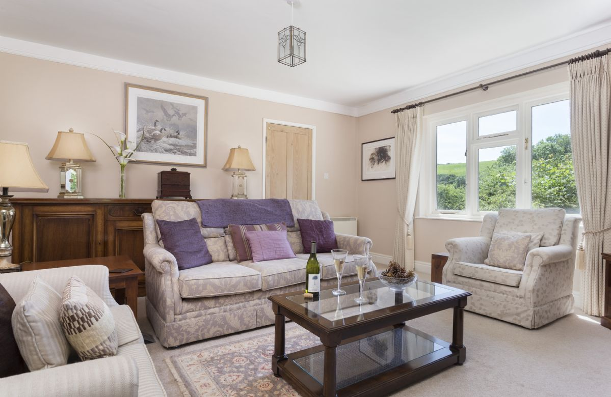 Ground floor: Spacious sitting room looking out over the beautiful countryside views