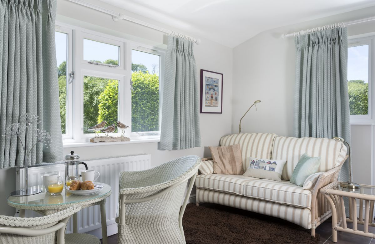 Ground Floor: Separate entry through french doors leads you to a cosy sitting room with double bed and en-suite shower room. Enjoy the views opening out to the patio and garden