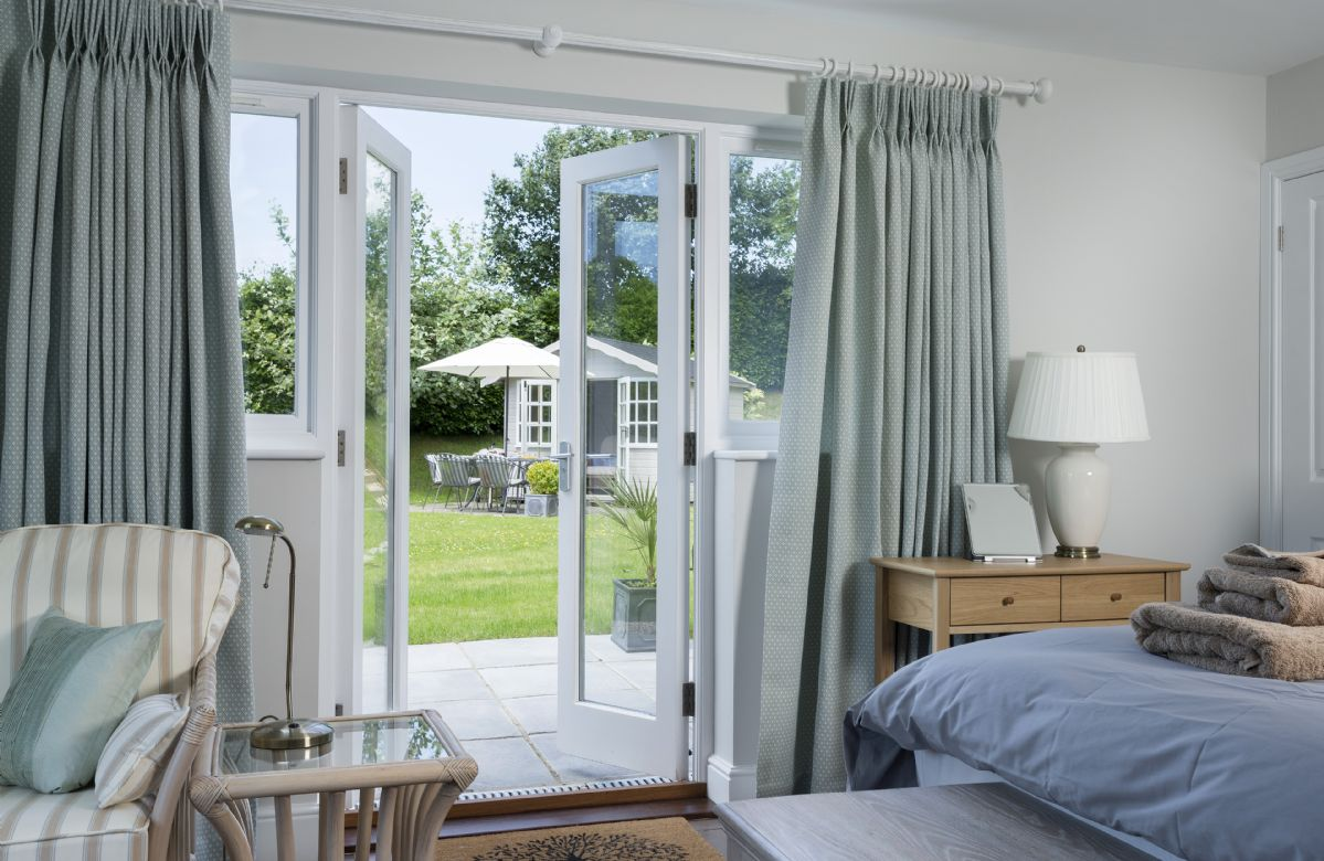 Ground Floor: Double bedroom with french doors leading out to the garden and the quaint Summer House