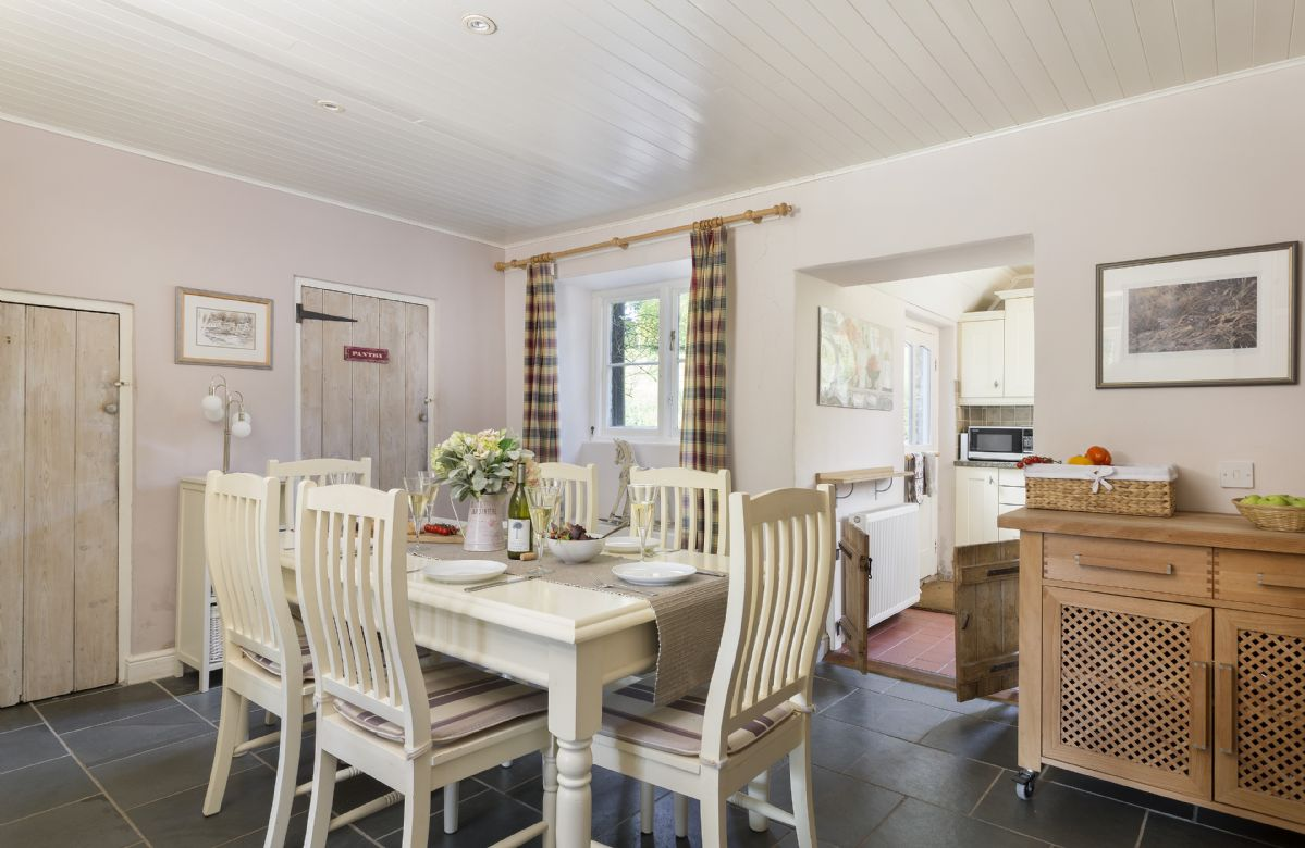 Ground floor: Large open plan dining room with original rustic timber features and stone flooring