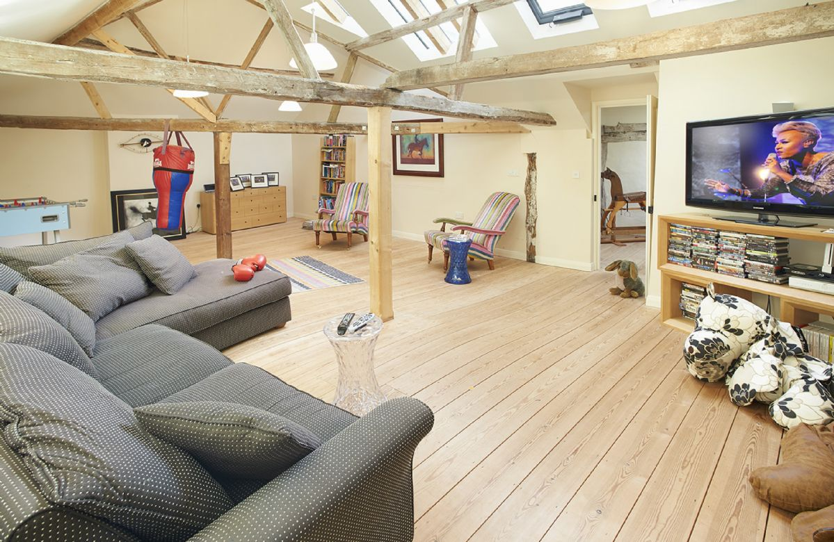 Second floor: Large family entertainment room with table football and adjoining room with weights and a dartboard