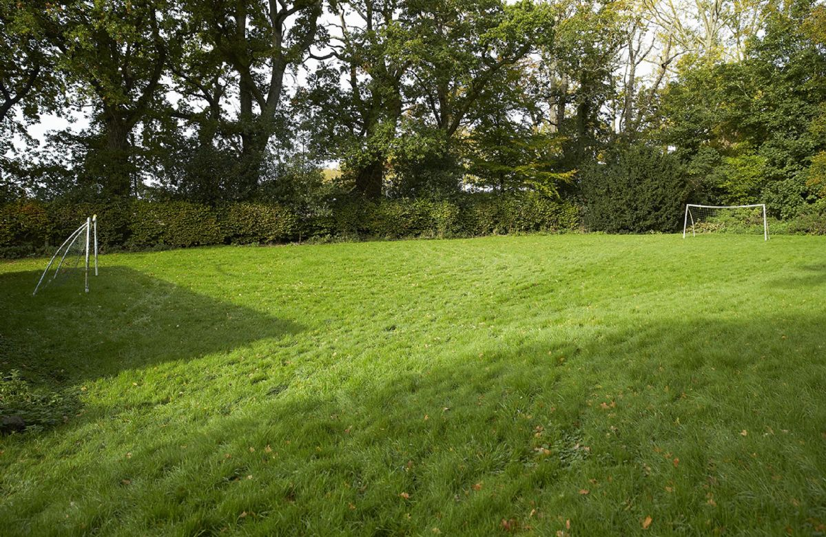 Five acres of grounds including a woodland, ponds, streams and lawns