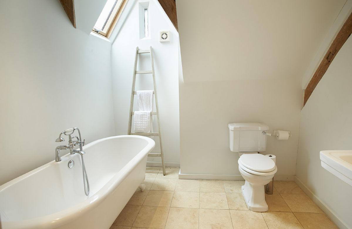 The Coach House: First floor bathroom with double ended roll top bath