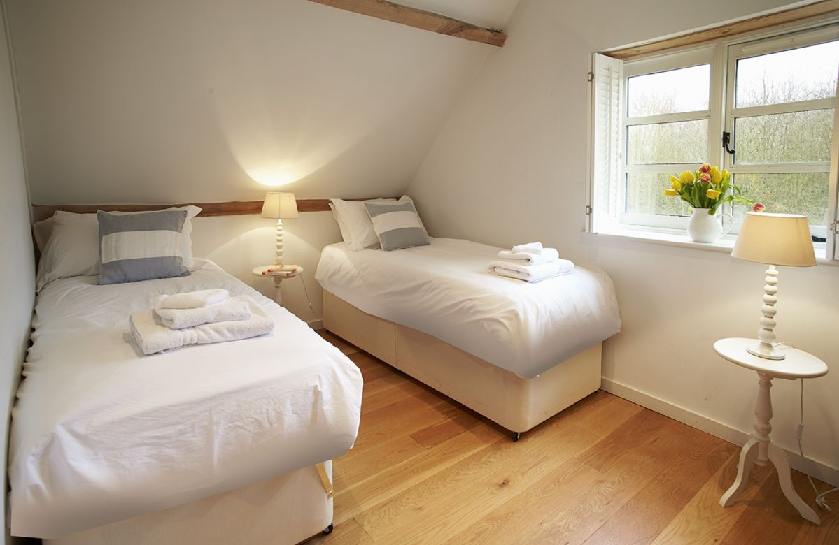 The Coach House: First floor twin bedroom with 3' zip and link beds (can convert to 6' double upon request)