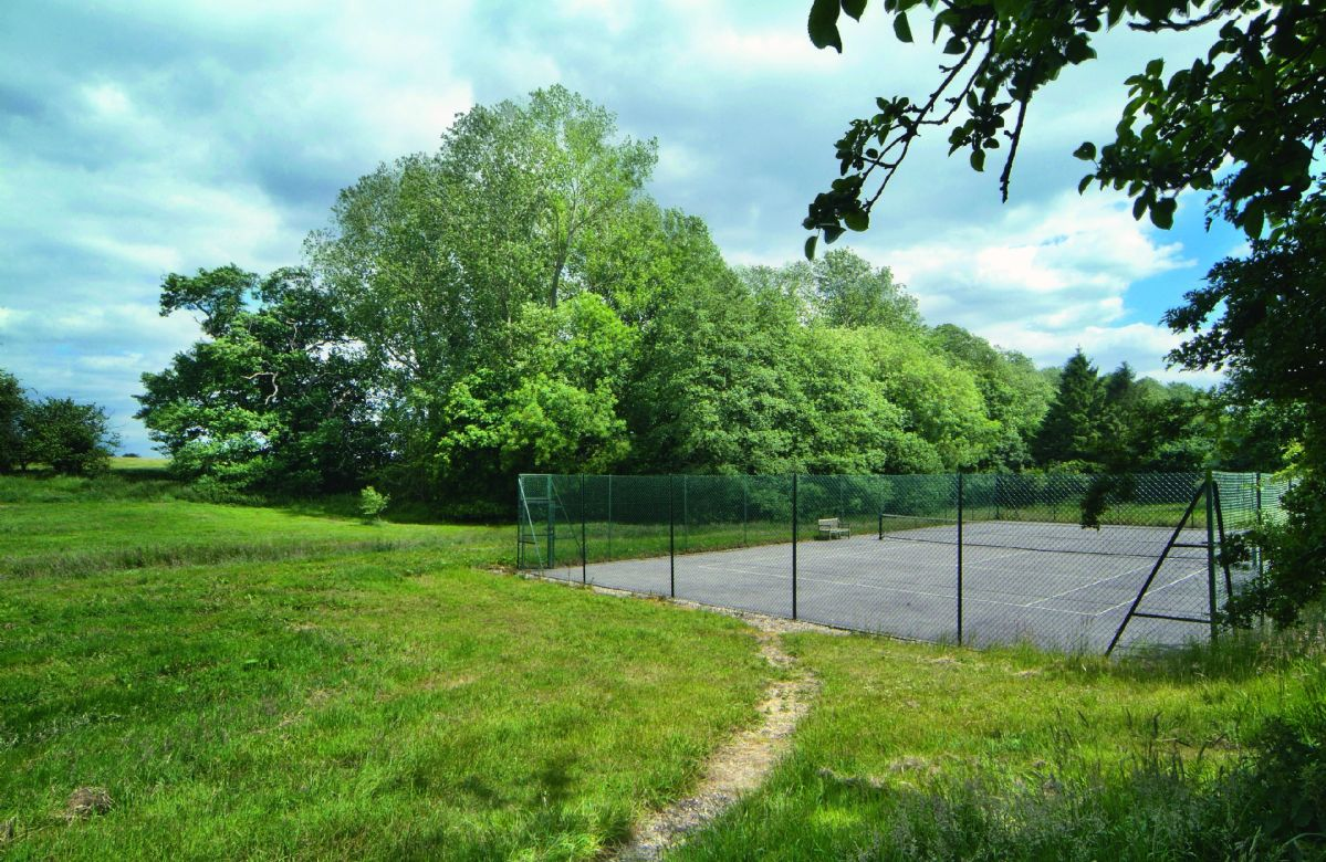 Use of an all weather tennis court in the grounds