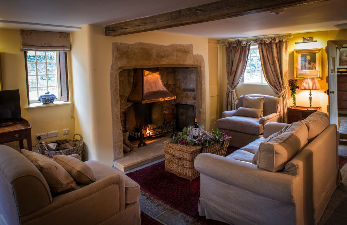 Ground floor:  Cosy sitting room with inglenook and open fire
