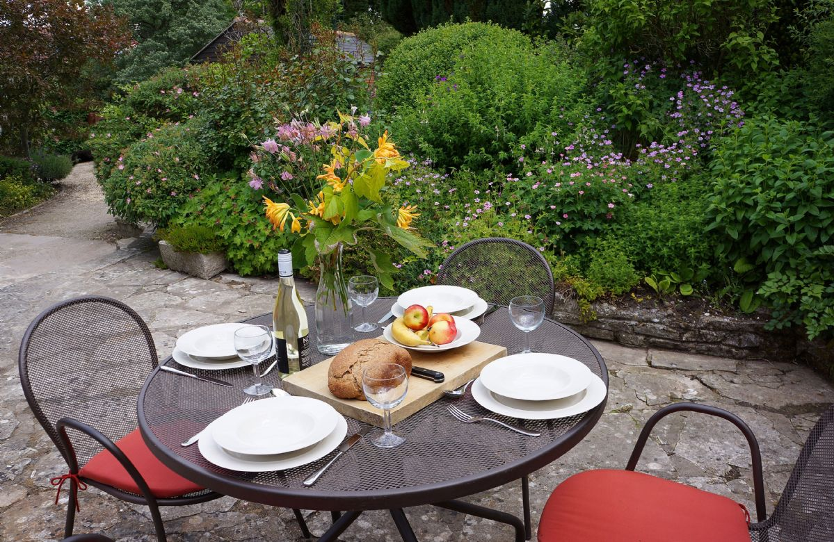 Al fresco dining overlooking the delightful garden