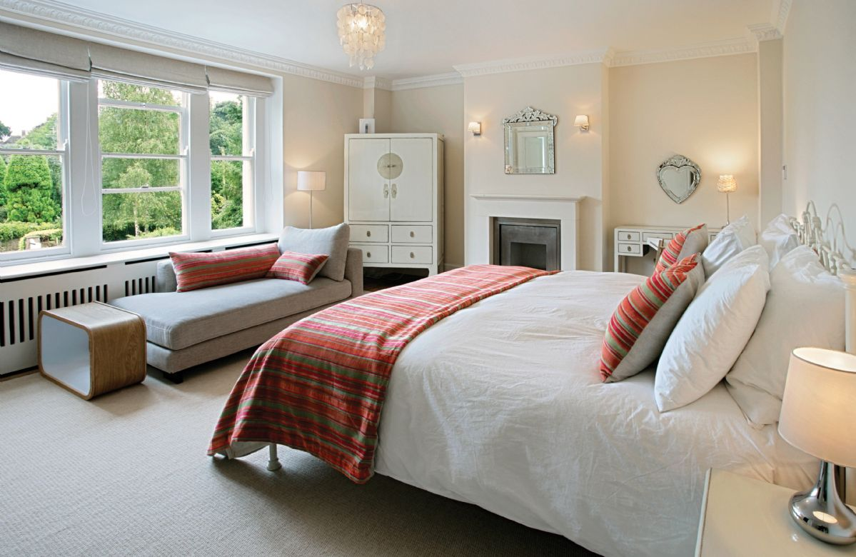First floor: Master bedroom with 6' bed, fireplace and chaise longue with adjoining en suite with walk in shower, double basin and bath