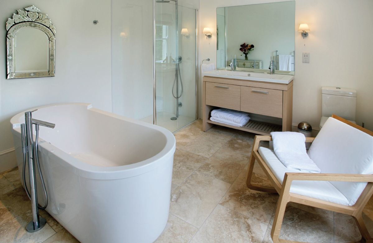First floor: Master bedroom en-suite with walk in shower, double basin and bath