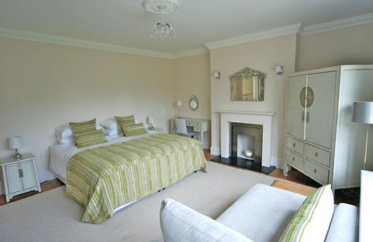 First floor: South facing double bedroom with 6' zip and link bed, fireplace and chaise lounge