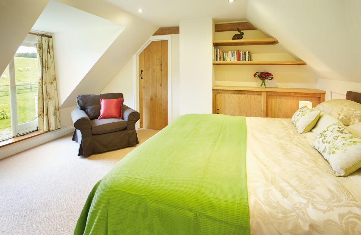 First floor:  Double bedroom with 6' zip and link bed which can convert into two single 3' beds upon request
