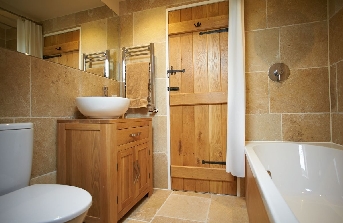 First floor:  En-suite bathroom with shower over bath
