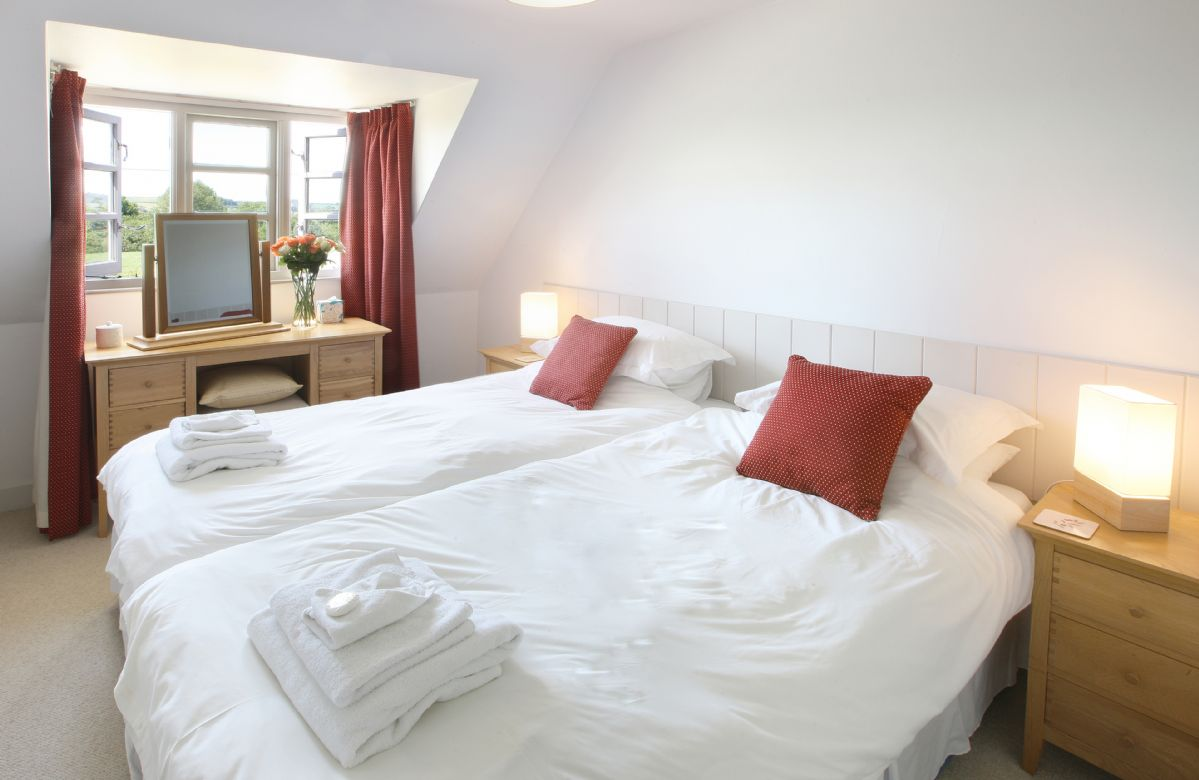 First floor:  Twin bedroom with 3' single beds which can convert to 6' double on request