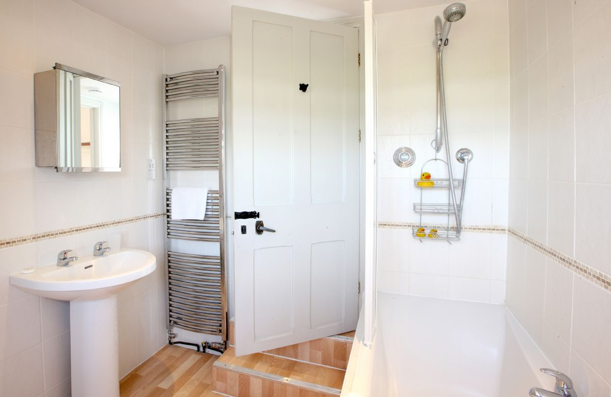 First floor:   Family bathroom with double ended bath, power shower and wc