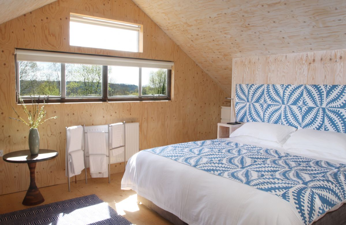 First floor: The master bedroom, with the roof open to the apex and a wood burning stove