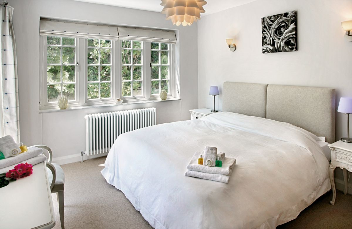 Ground floor: Double bedroom with 6' bed which can be converted to two 3' singles on request