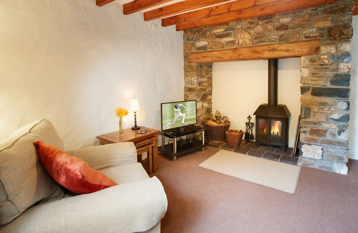 Ground floor: Sitting room with woodburner