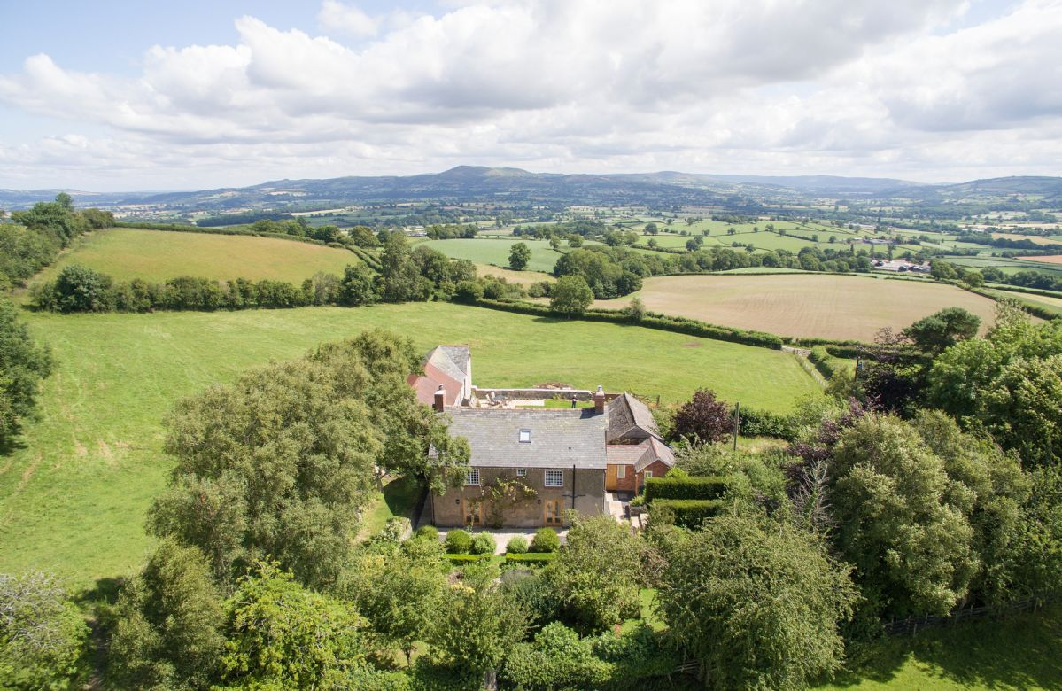 Draenllwynellen: Completely private, set in its own acre of land with orchard, ornamental garden and rustic outbuildings