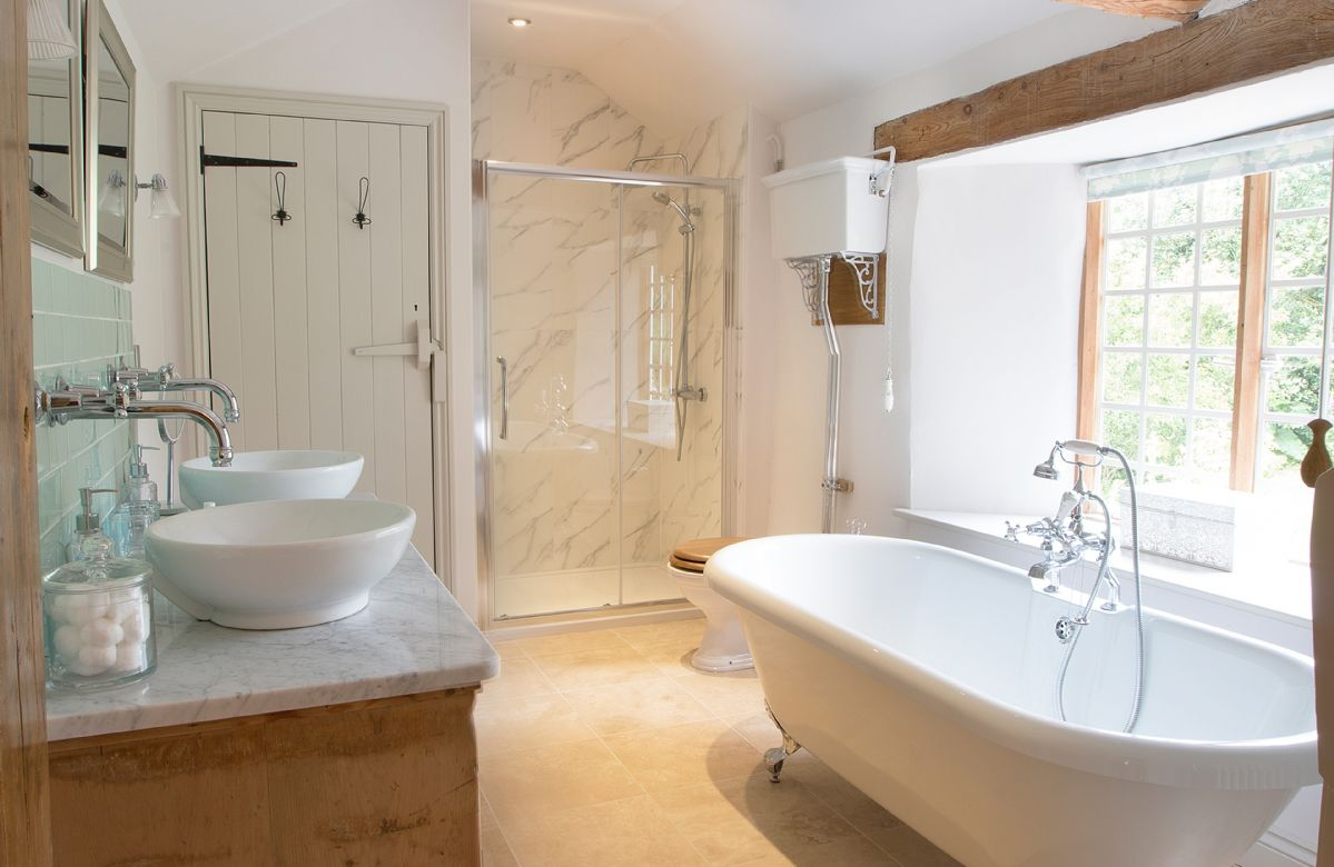 First floor: family bathroom with claw foot, free standing bath with shower attachment, twin basin marble topped wash stand, large walk in shower and underfloor heating
