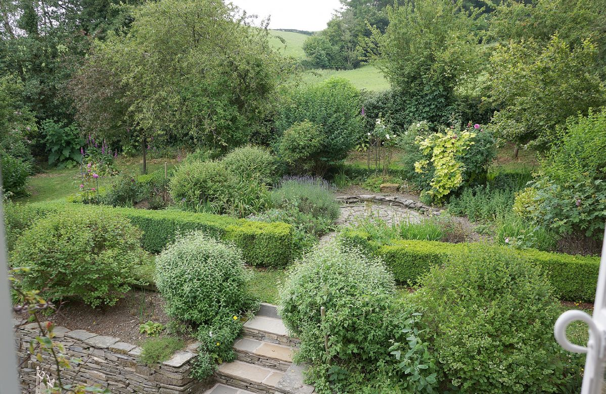 Set in its own acre of land with orchard and ornamental garden and rustic outbuildings