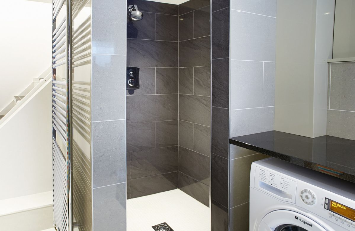 Basement:  Wet room and utility room with large walk-in shower