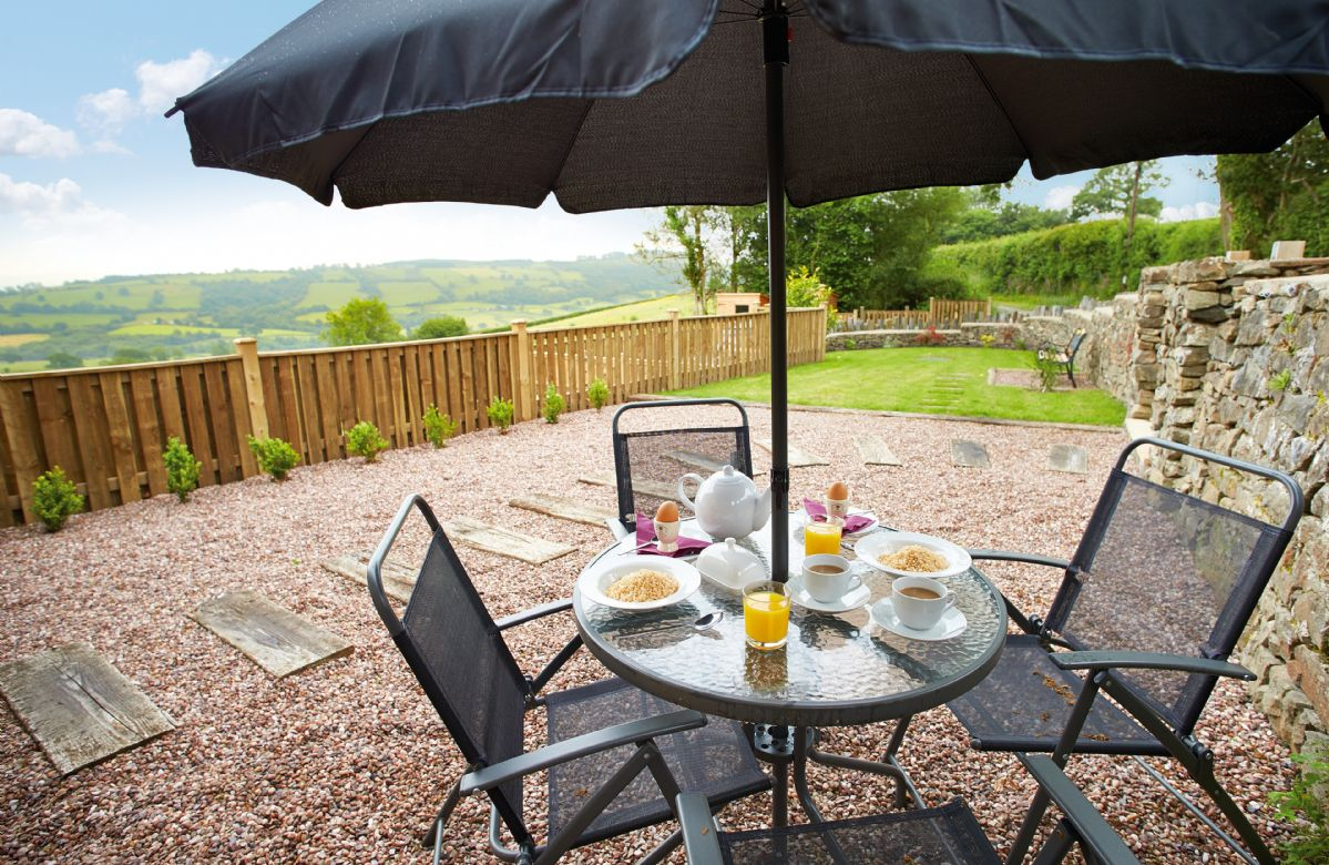 Garden with patio furniture, barbecue and wonderful views