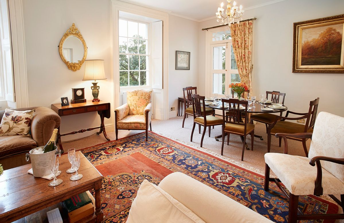 Ground floor: Elegant sitting room with dining table and chairs