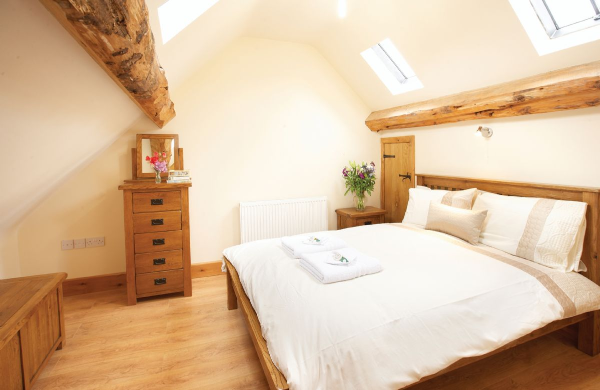 First floor: Double bedroom with a 4' 6 bed and en suite bathroom