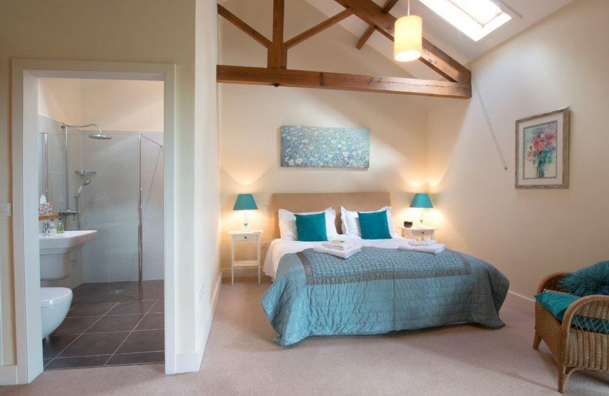 Ground floor:  Master bedroom with a 6' bed and an en-suite shower wet room
