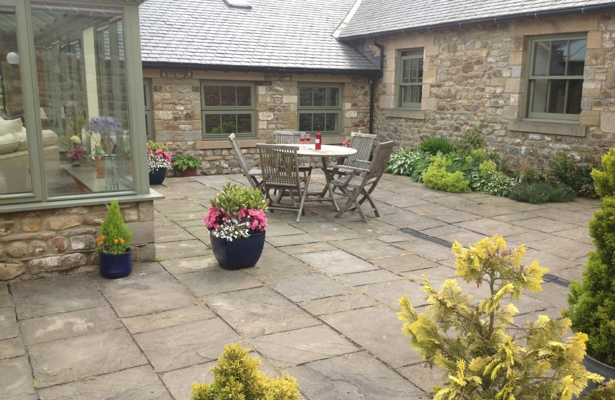 Private courtyard with garden furniture