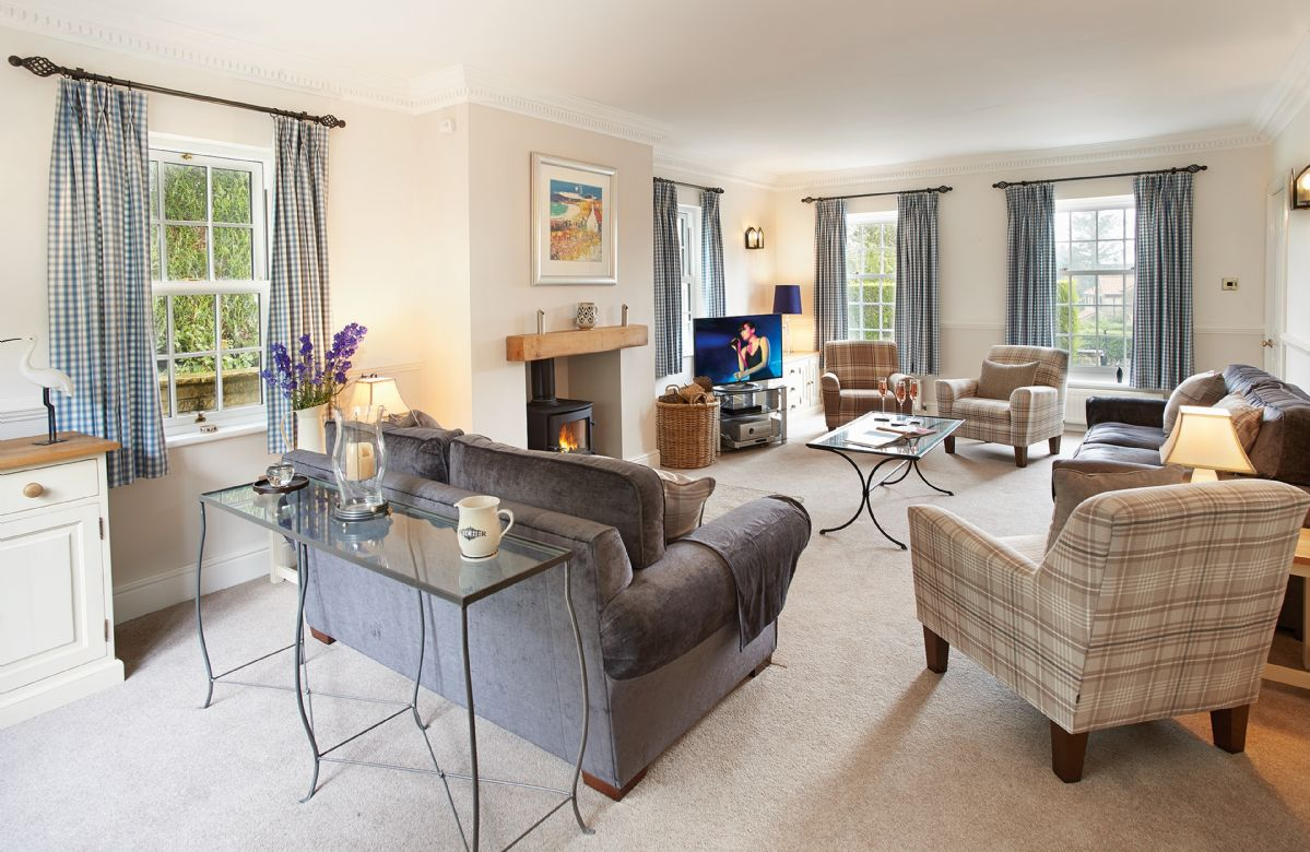 Ground floor:  Large sitting room with wood burning stove and French windows to terraces and garden