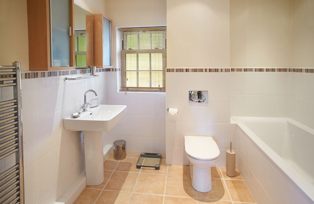 First floor:  Bathroom with bath, separate power shower and wc