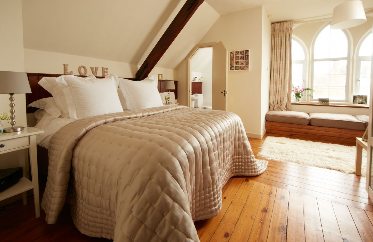 First floor:  Master bedroom with 5' bed, large gothic picture window with window seat