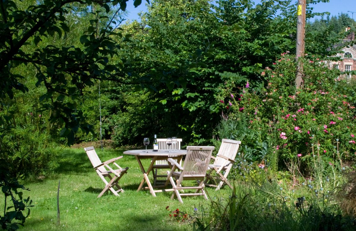 Traditional cottage garden situated at the foot of the slope up to Haughton Castle
