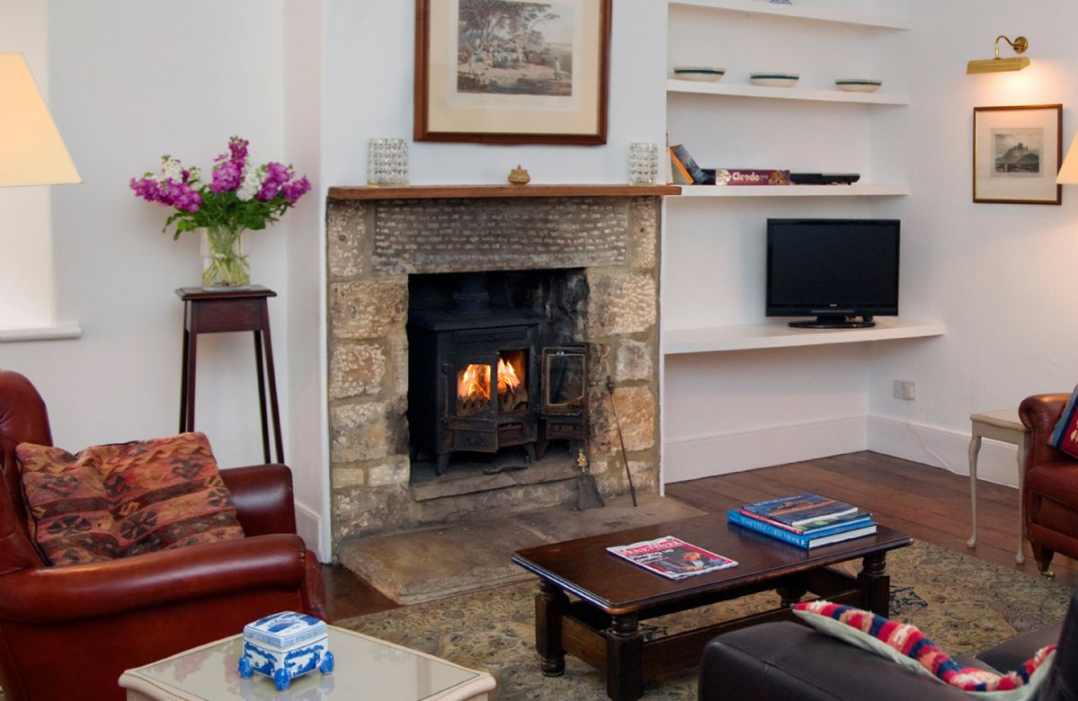Ground floor:  The comfortable, cosy sitting room with solid fuel stove