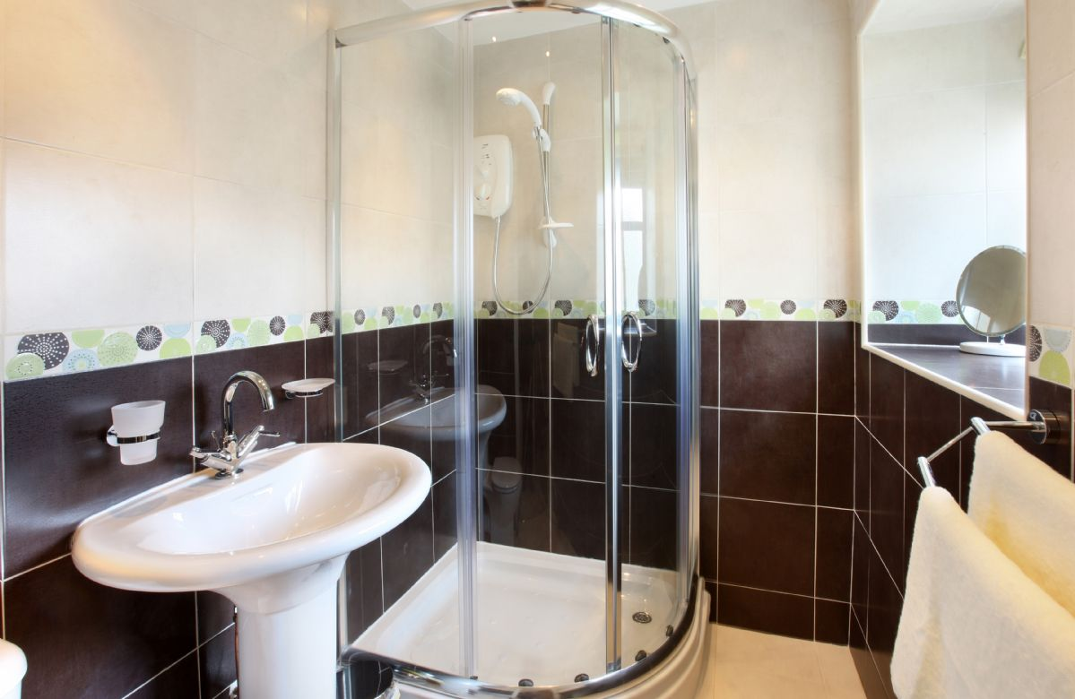 Damson Cottage:  First floor: Fully tiled bathroom with bath, wc and basin