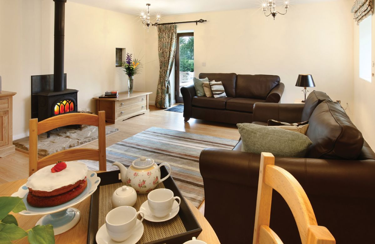 Damson Cottage:  Ground floor: Large living room with single patio door and access to private patio and garden area