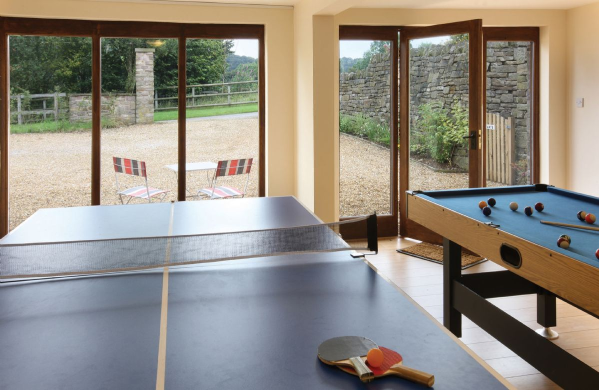 Use of a games room with table tennis and pool tables