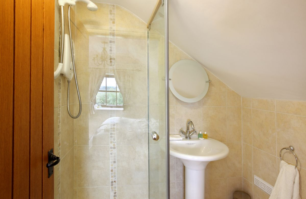 Orchard Cottage:  First floor: En-suite shower room, wc and basin