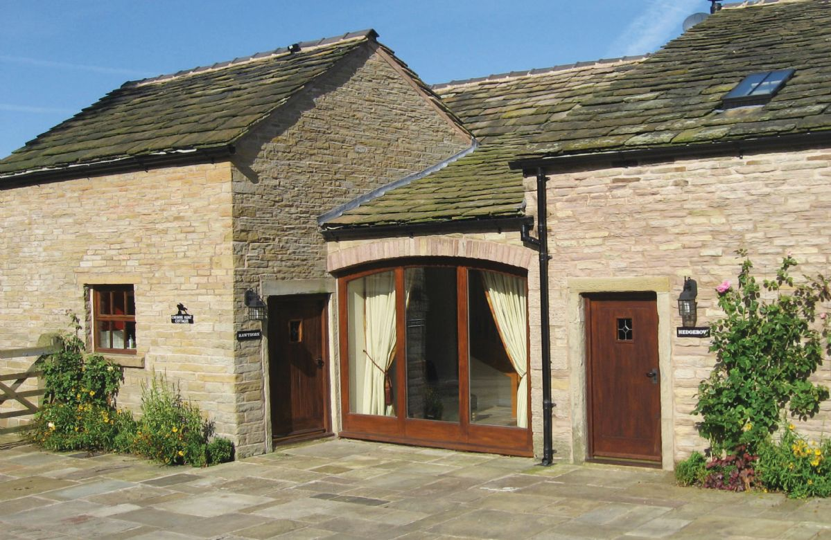 Damson Cottage is to the right of the full length window