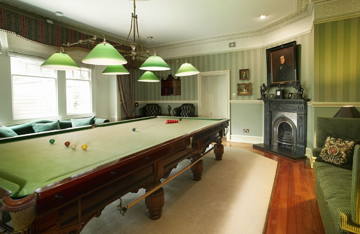 Ground floor:  Original billiard room decorated in the style of a gentleman's club with stunning full size antique table, score board, cue stand and large sofas
