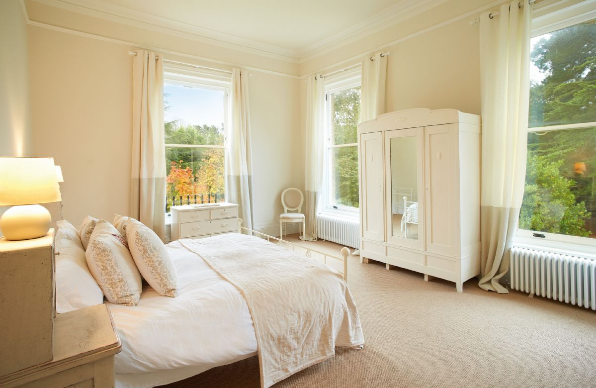 First floor: Double bedroom with 6' bed with adjoining bathroom