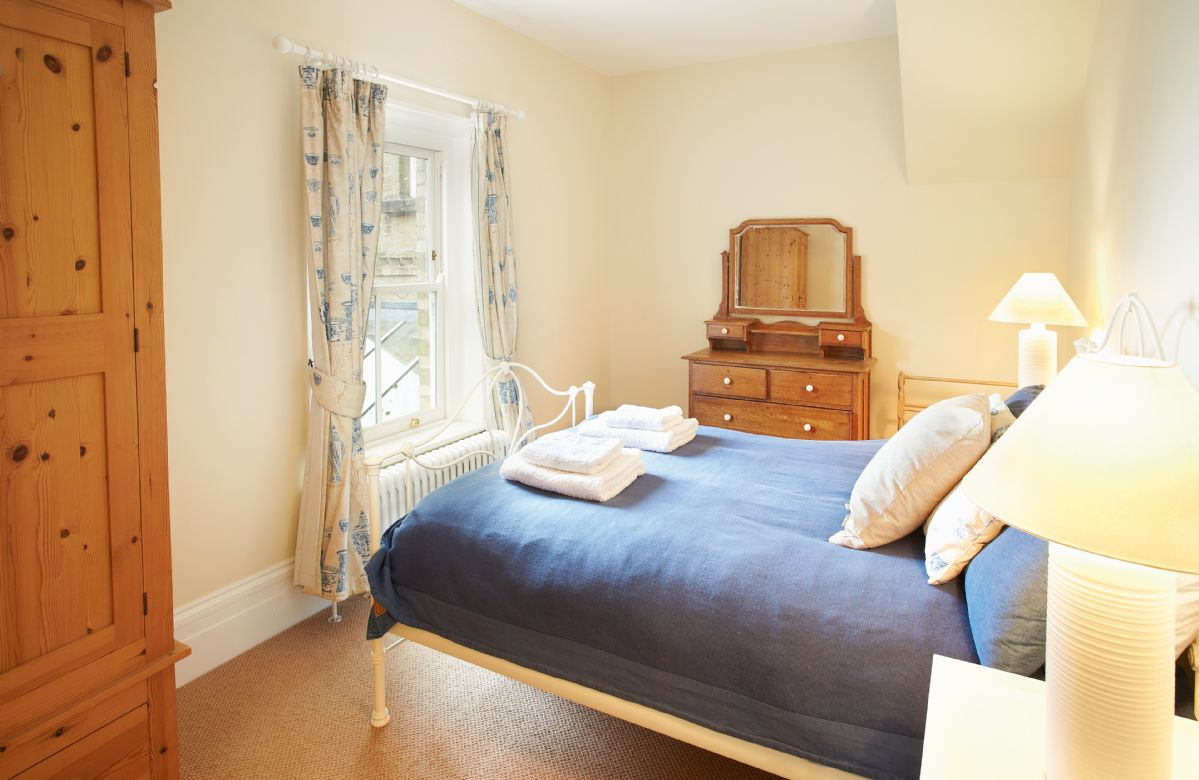 First floor west wing:  Double bedroom with 4'6 bed