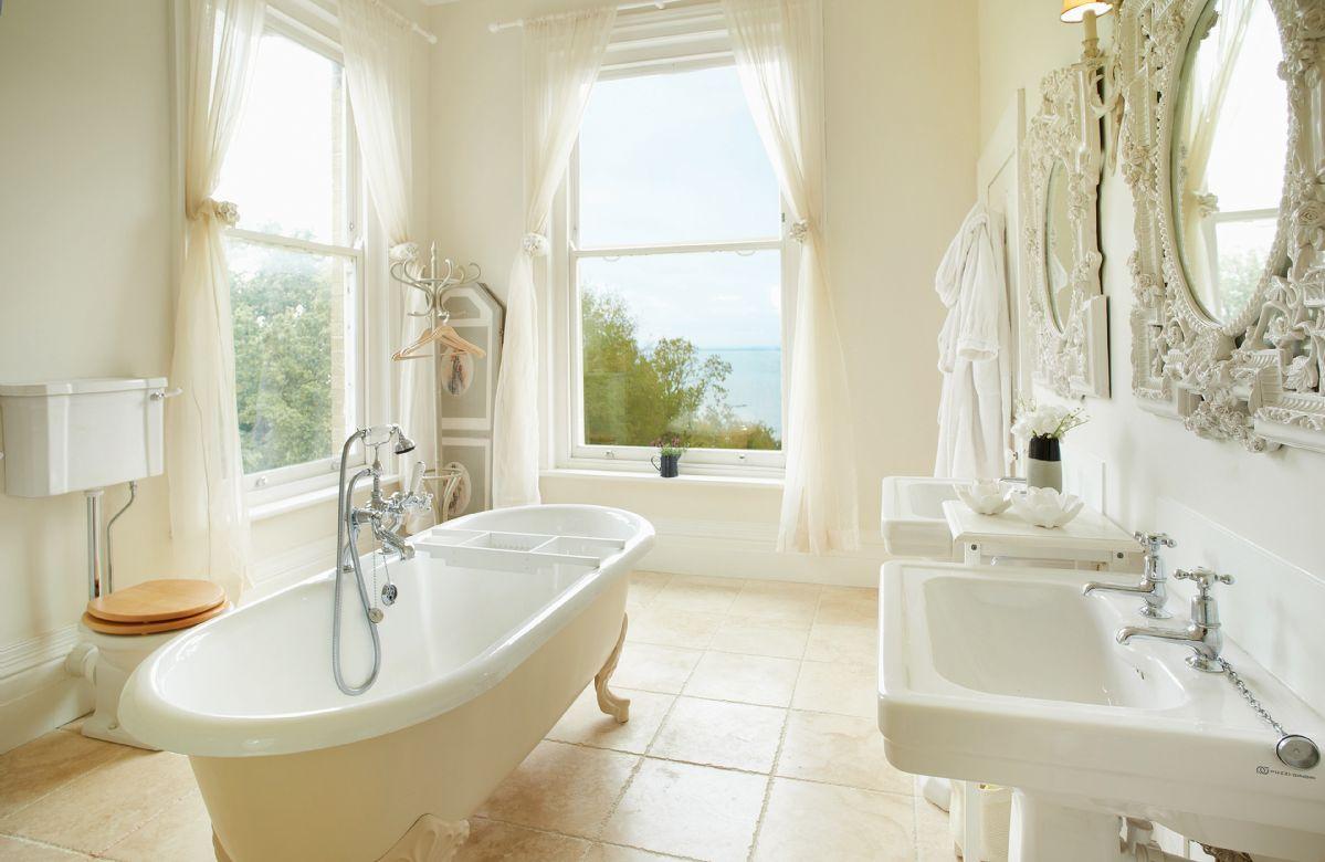 First floor: En-suite bathroom with separate shower to master bedroom