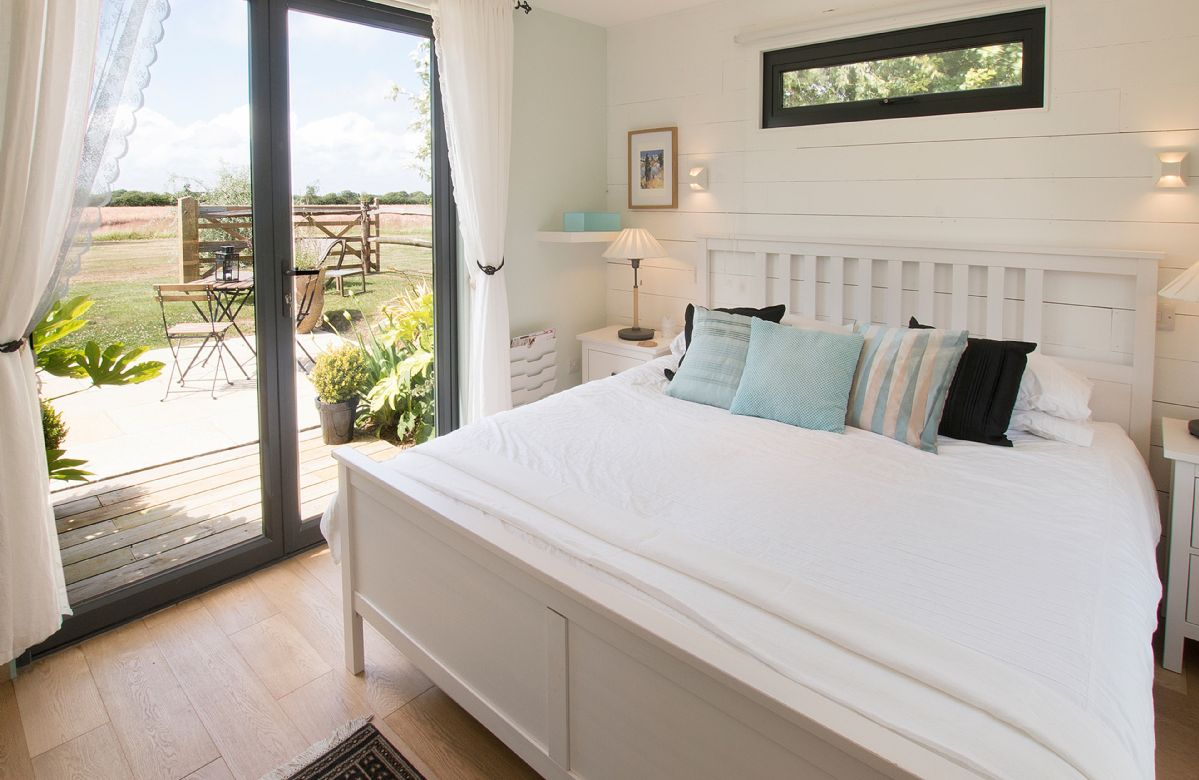 Ground floor:  Double bedroom (accessed via covered access) with 6' bed and open plan en-suite bathroom