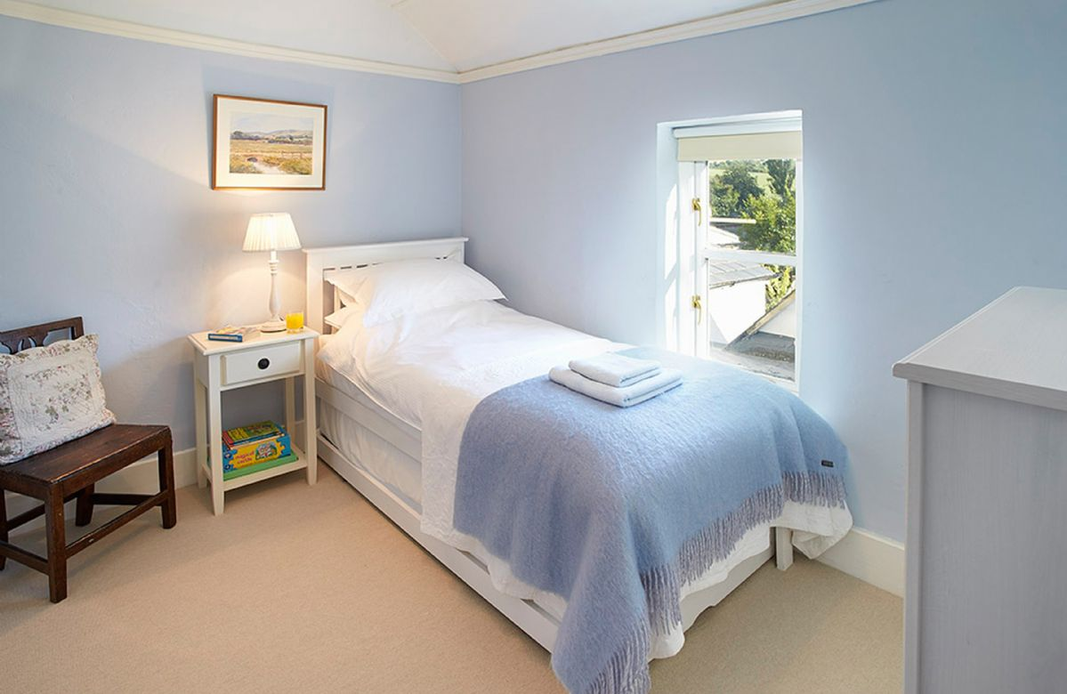 First floor: Single bedroom with single 3' bed with pull out truckle bed suitable for a child