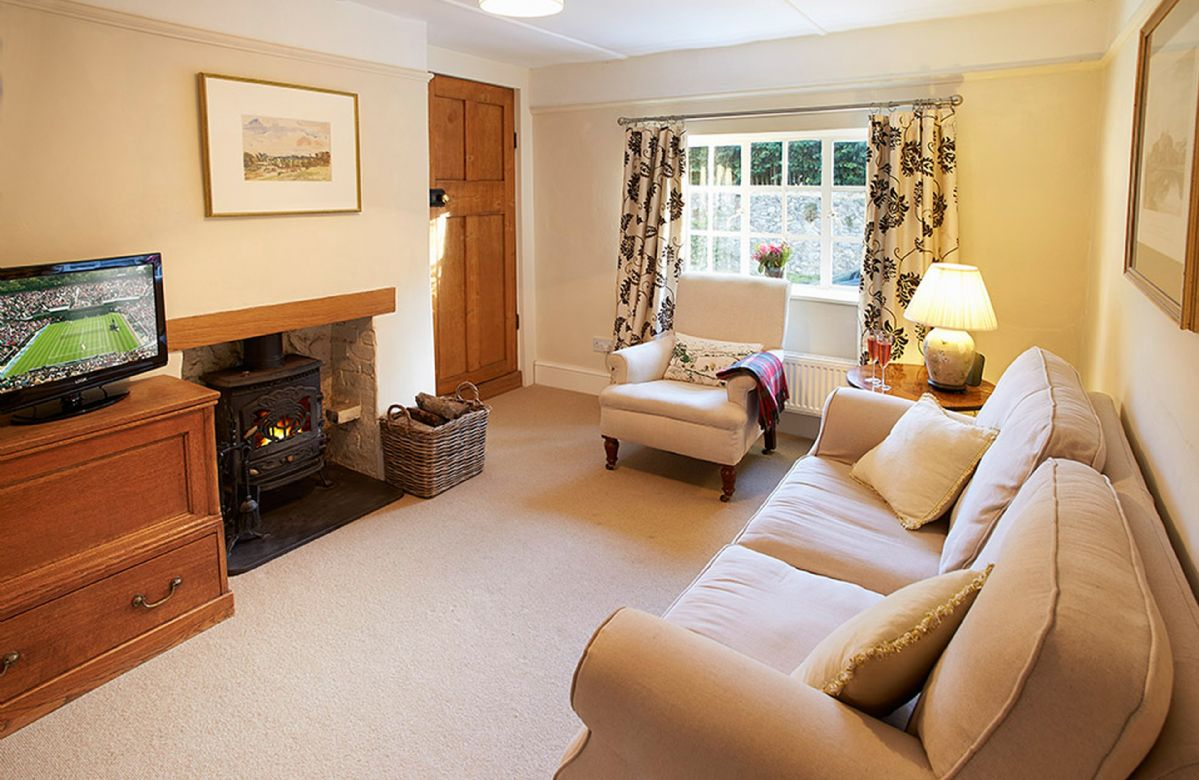 Ground floor:  Sitting room with a wood burning stove