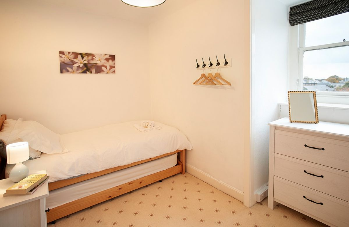 Second floor: Bedroom with 3' single bed and pull out trundle bed